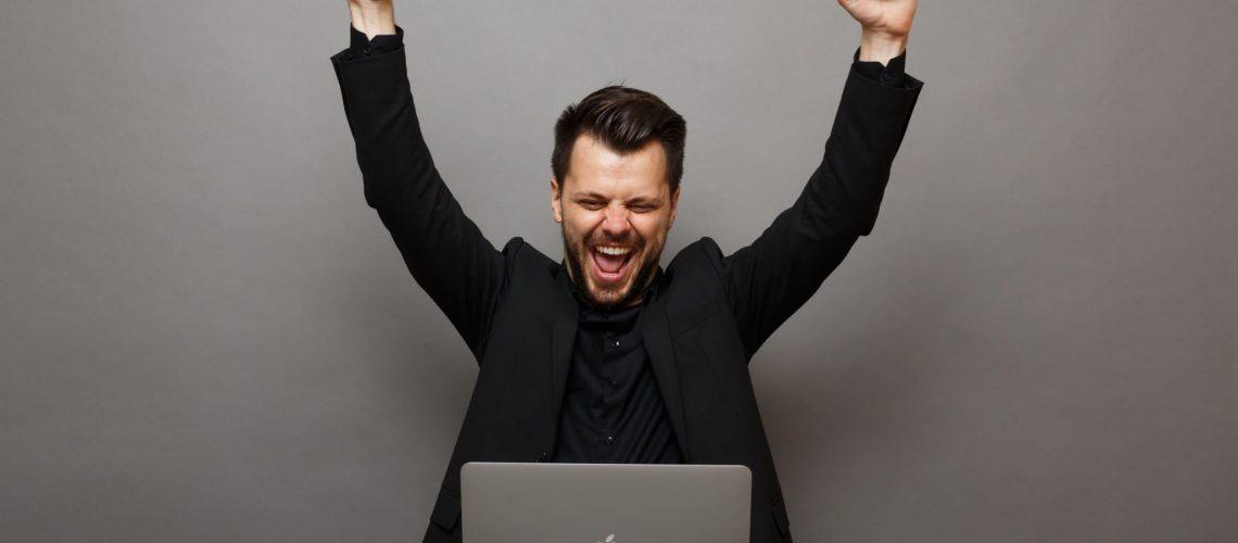 business-studio-man-laptop-happy-beard-work-success-bearded-man-using-laptop_t20_XzX7jR